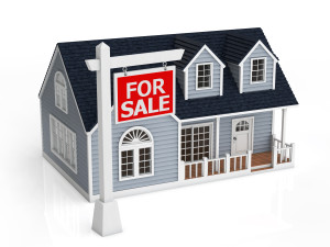Sale of house. The sign of sale in front of the house