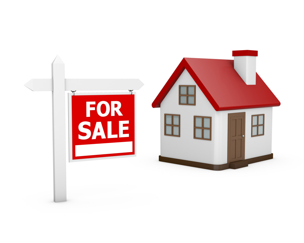 Small house for sale on white background. 3d rendered image