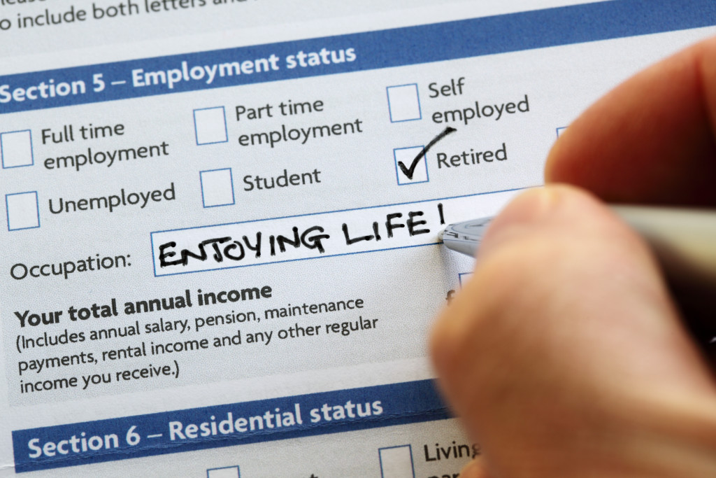 Writting retired and enjoying life on an application form concept for a comfortable retirement