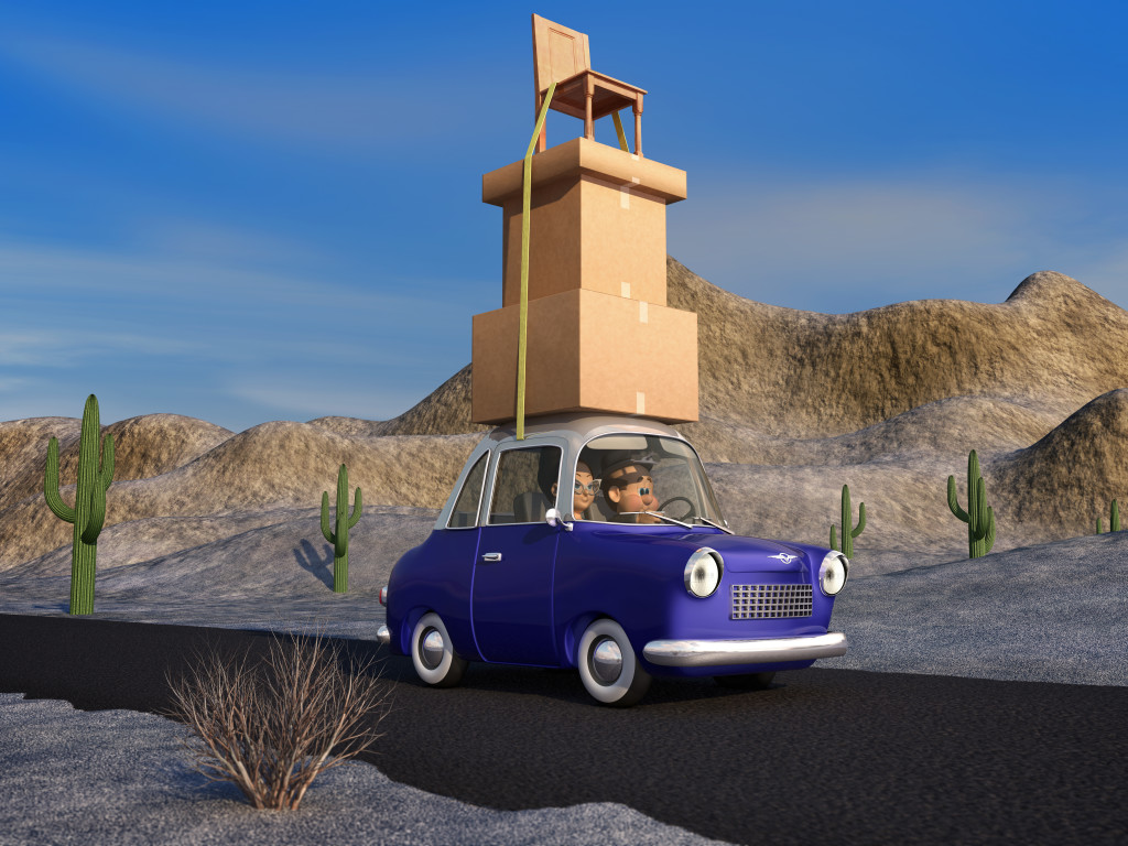 A cartoon family driving through the desert in a cartoon car carrying a load of tall stack of boxes and a chair that is strapped to the car.
